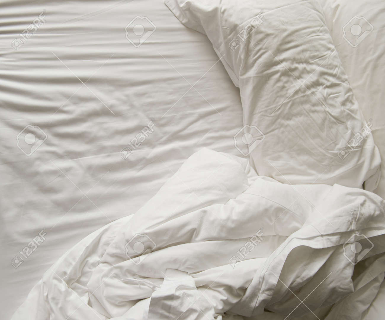 Marvelous Close Up Of Messy Bedding Sheets And Pillow Stock Photo   24905335