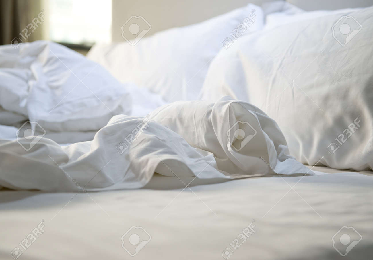 close up of messy bedding sheets and pillow stock photo picture and