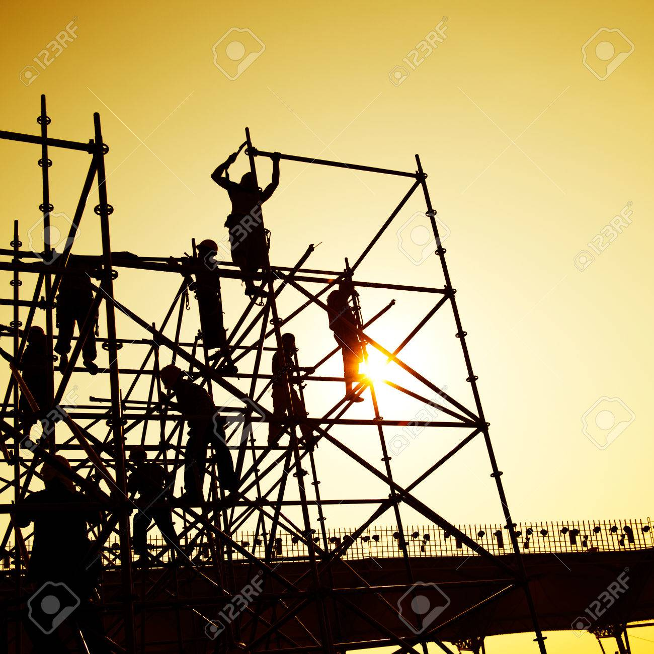 Construction workers working on scaffolding Stock Photo - 24906503