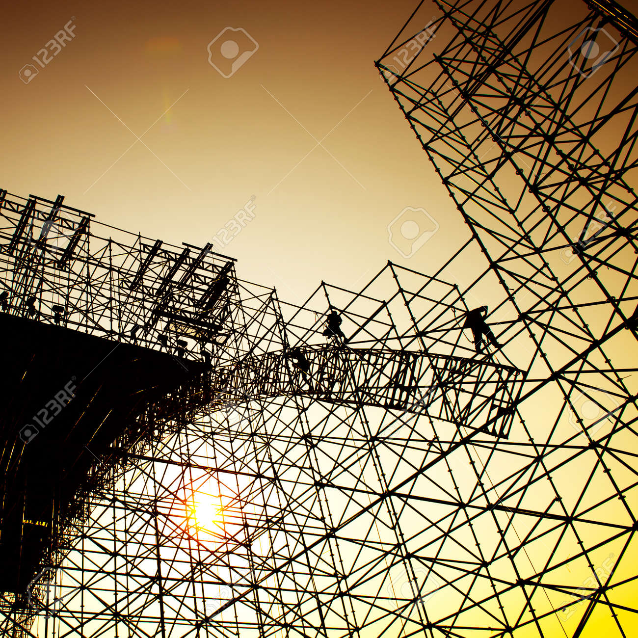 Construction workers working on scaffolding Stock Photo - 24906564