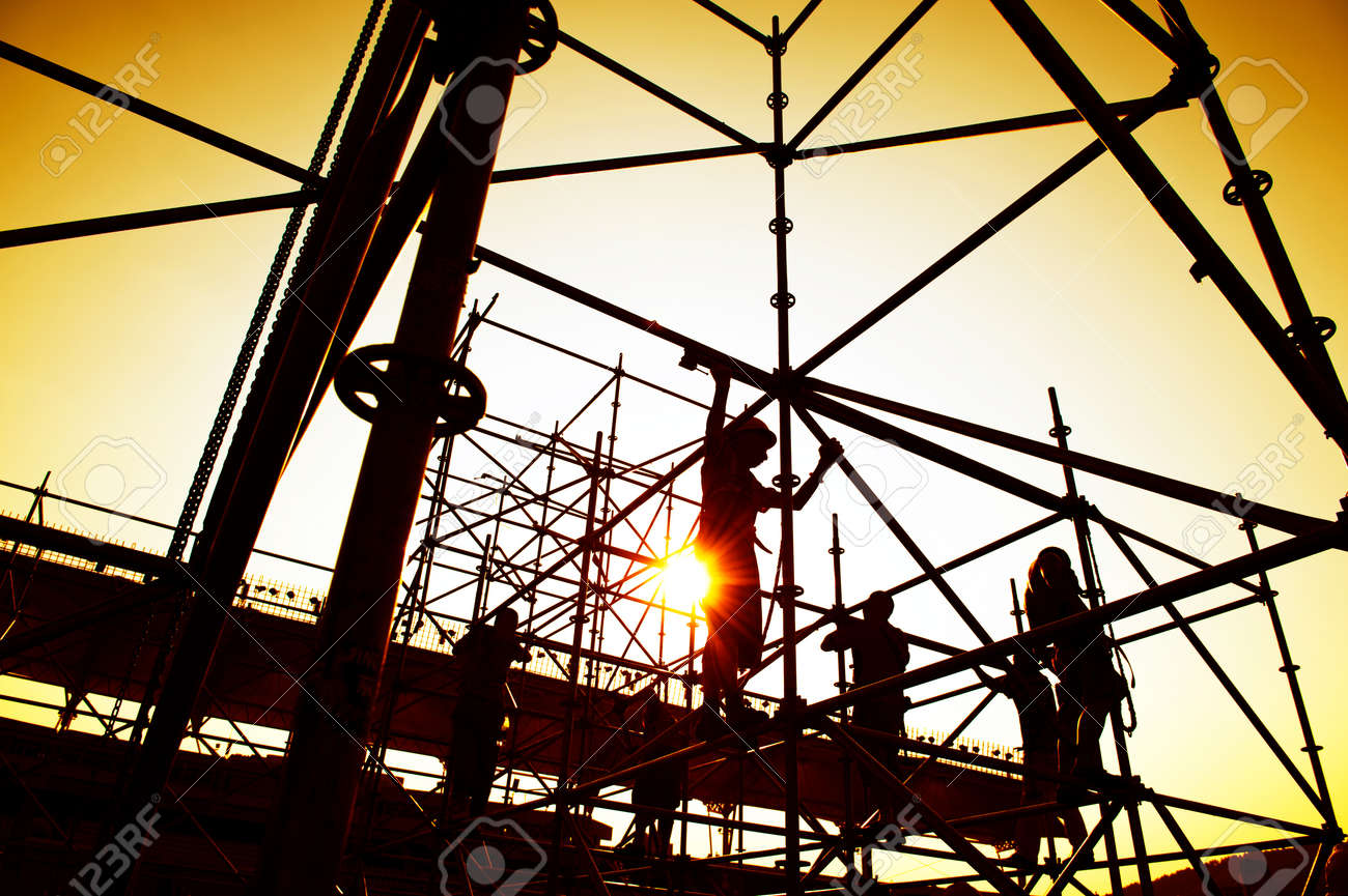 Construction workers working on scaffolding Stock Photo - 24906627