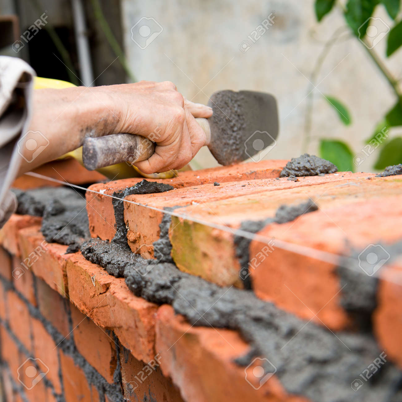 builder laying bricks in site. Stock Photo - 24936313