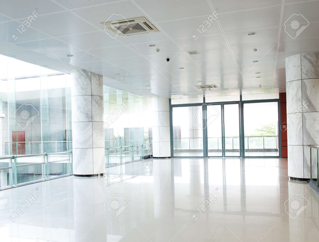 empty long corridor in the modern office building. Stock Photo - 27403338