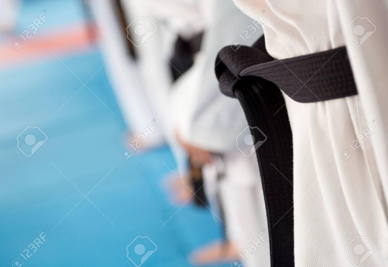 People in martial arts training exercising Taekwondo. Stock Photo - 33707542