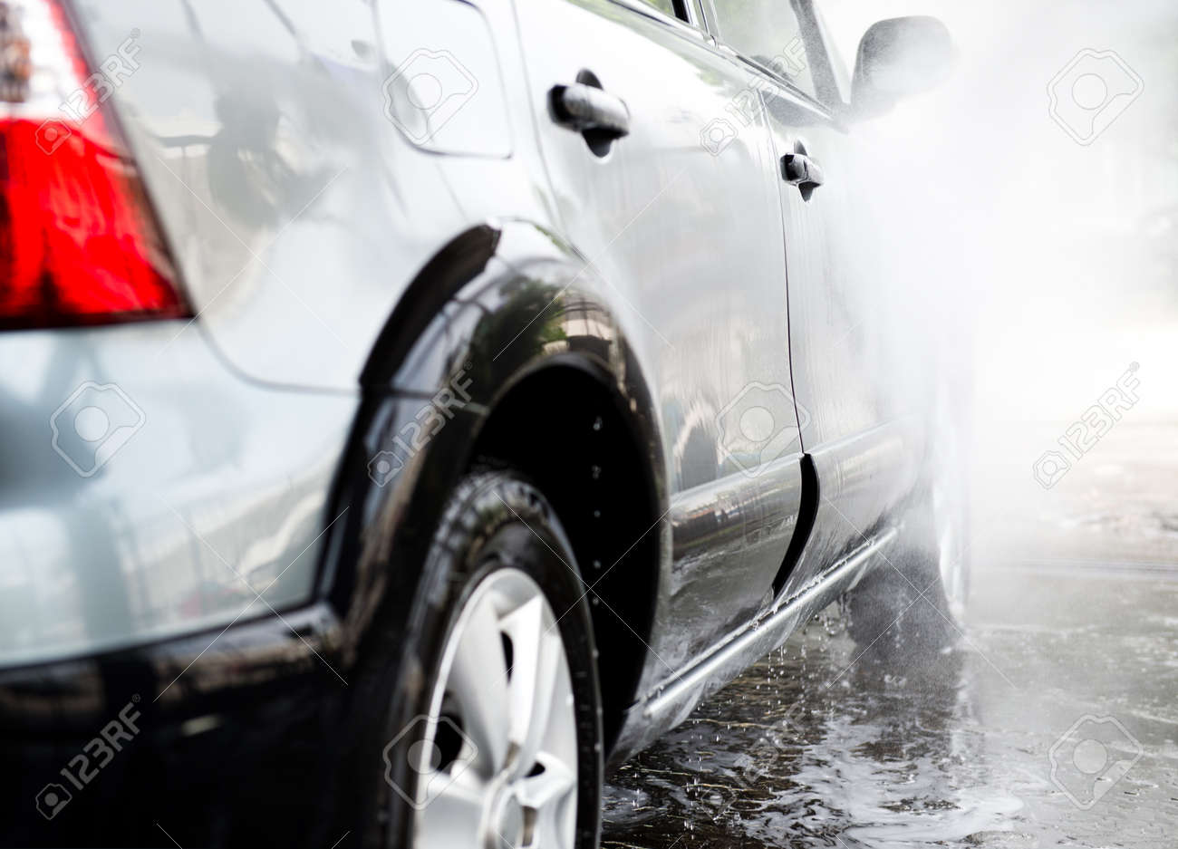 Car wash with flowing water and foam. Stock Photo - 33707662