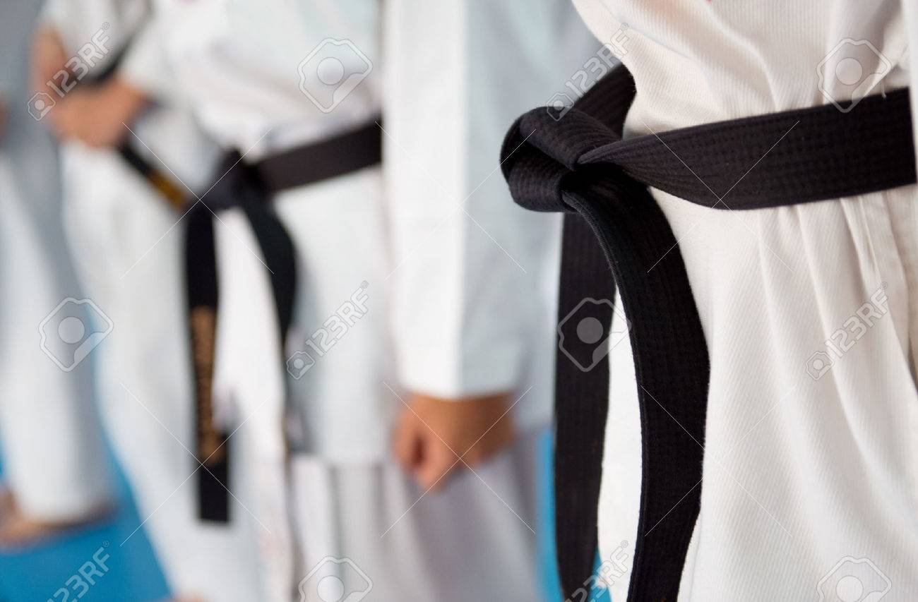 People in martial arts training exercising Taekwondo. Stock Photo - 33715817