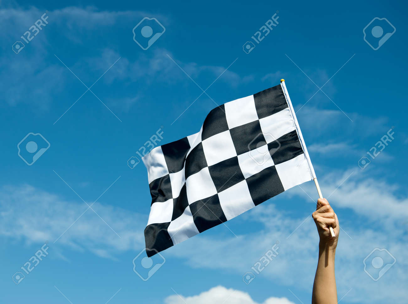 checkered race flag in hand. Stock Photo - 33756953