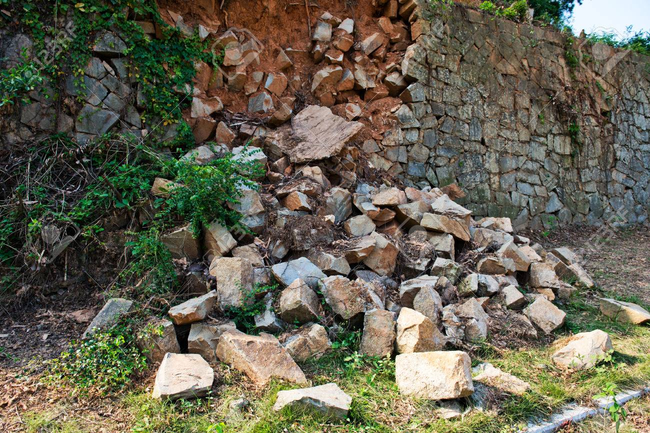 Broken stone wall after earthquake. Stock Photo - 33781194
