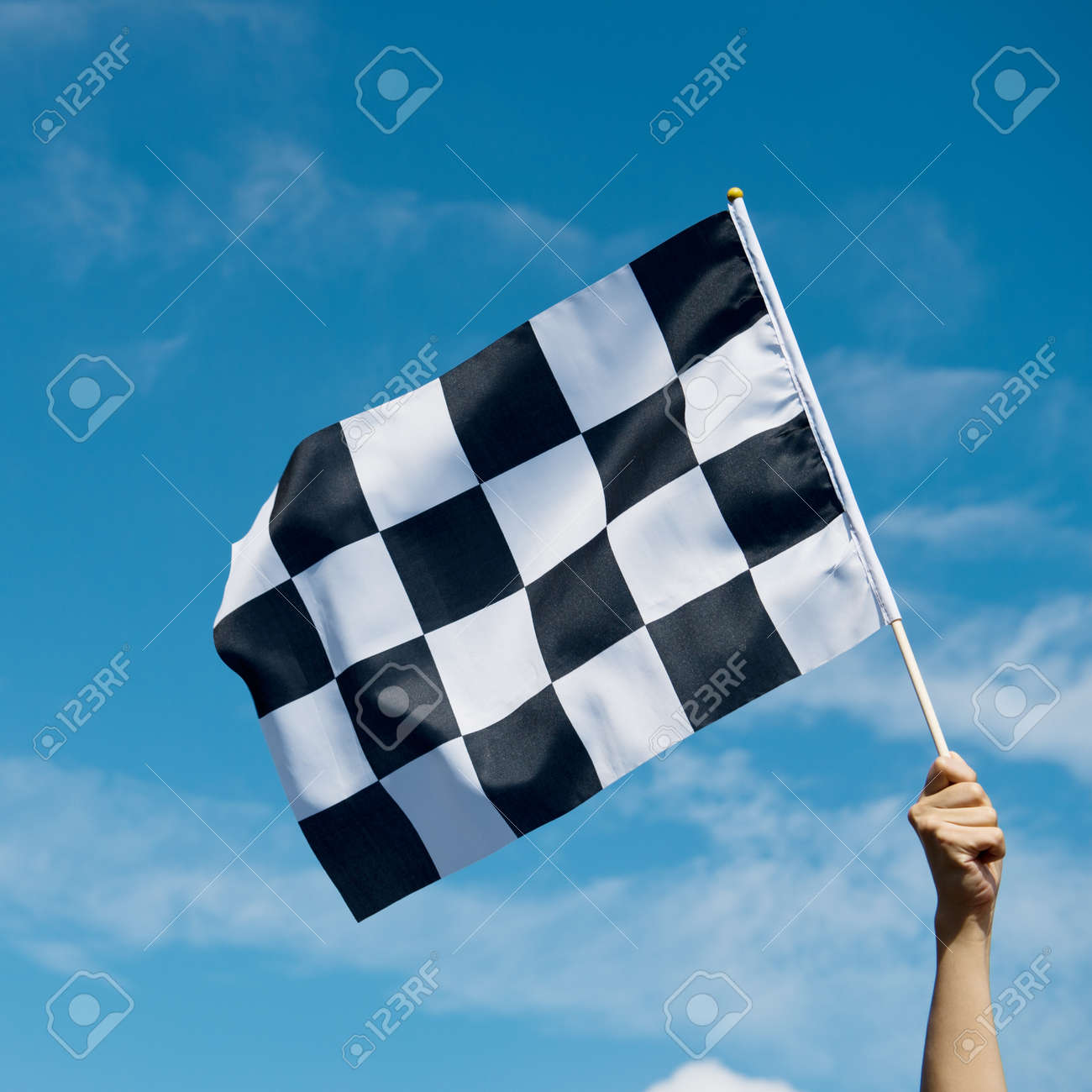 checkered race flag in hand. Stock Photo - 33782635