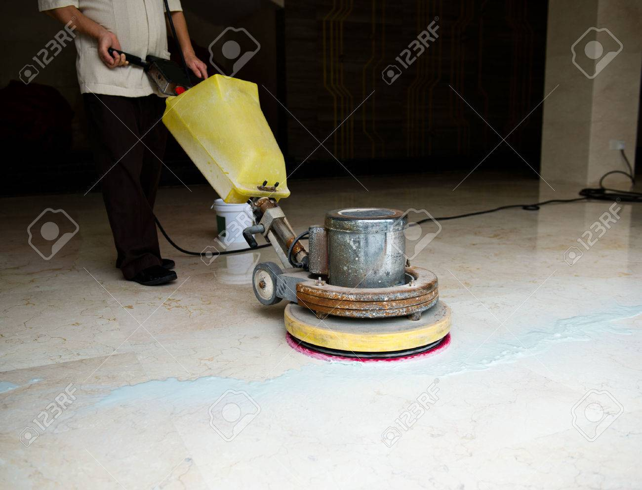 People cleaning floor with machine. Stock Photo - 33783855