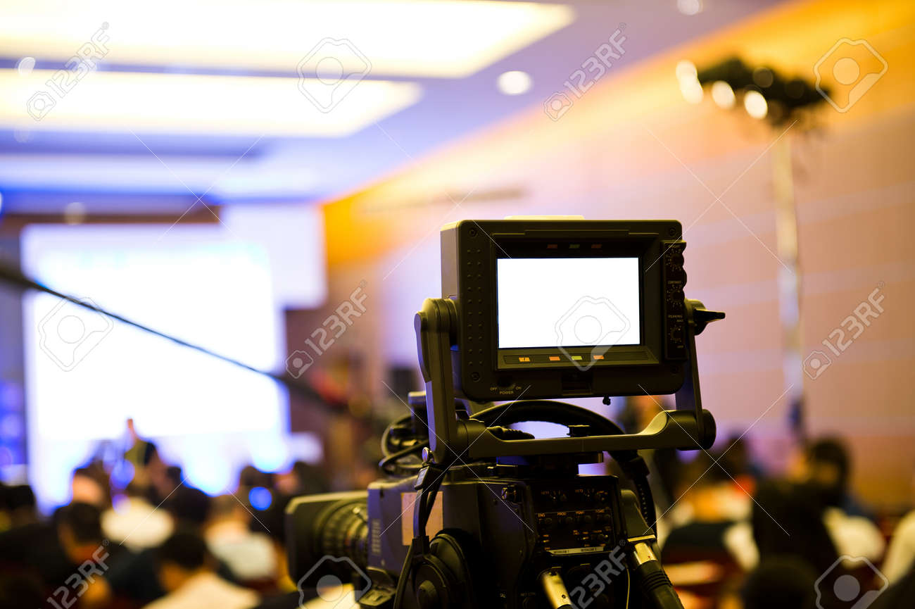 Live broadcasting, television operator with camera. Stock Photo - 33784683
