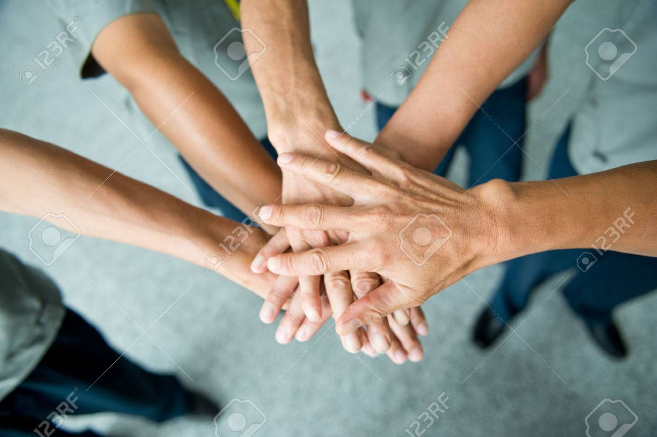 People with their hands together. team work concept Stock Photo - 33790427