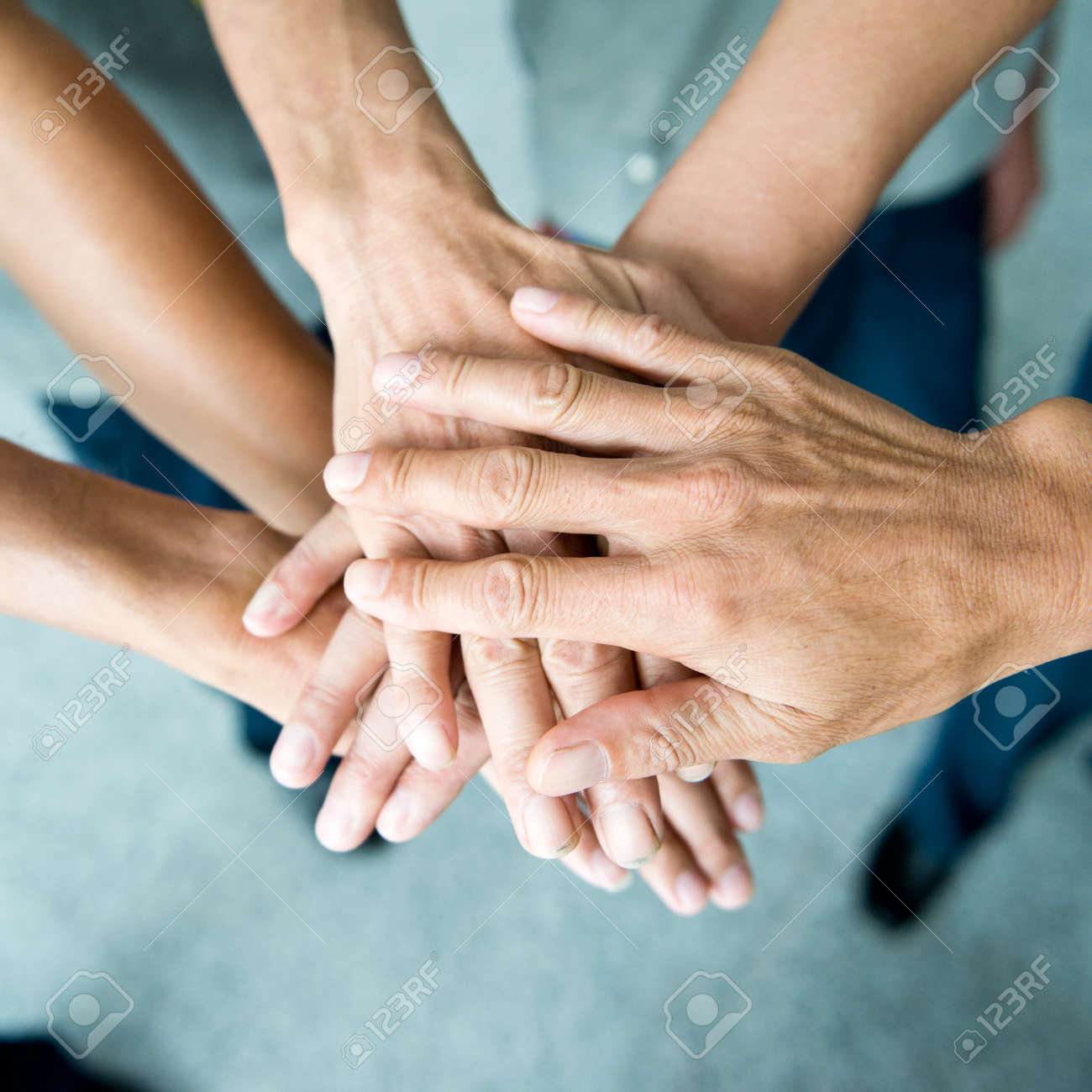 People with their hands together. team work concept Stock Photo - 33790434