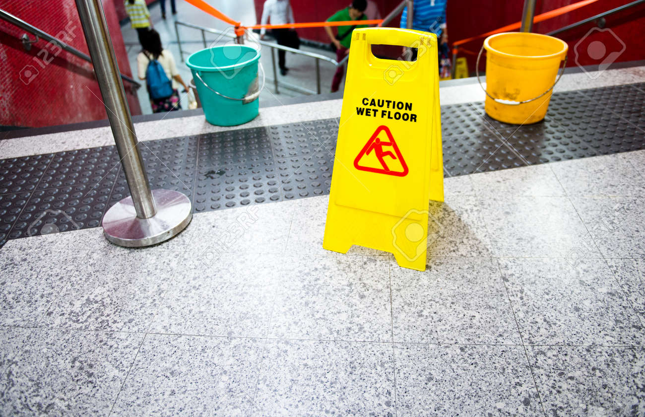 Wet floor caution sign near the stairs. Stock Photo - 35223137
