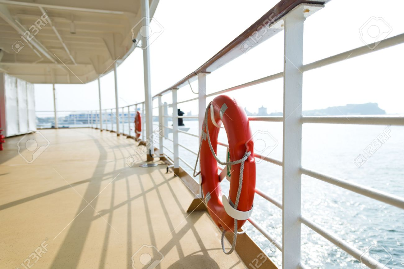 Life buoy on the deck of cruise ship. Stock Photo - 35234817