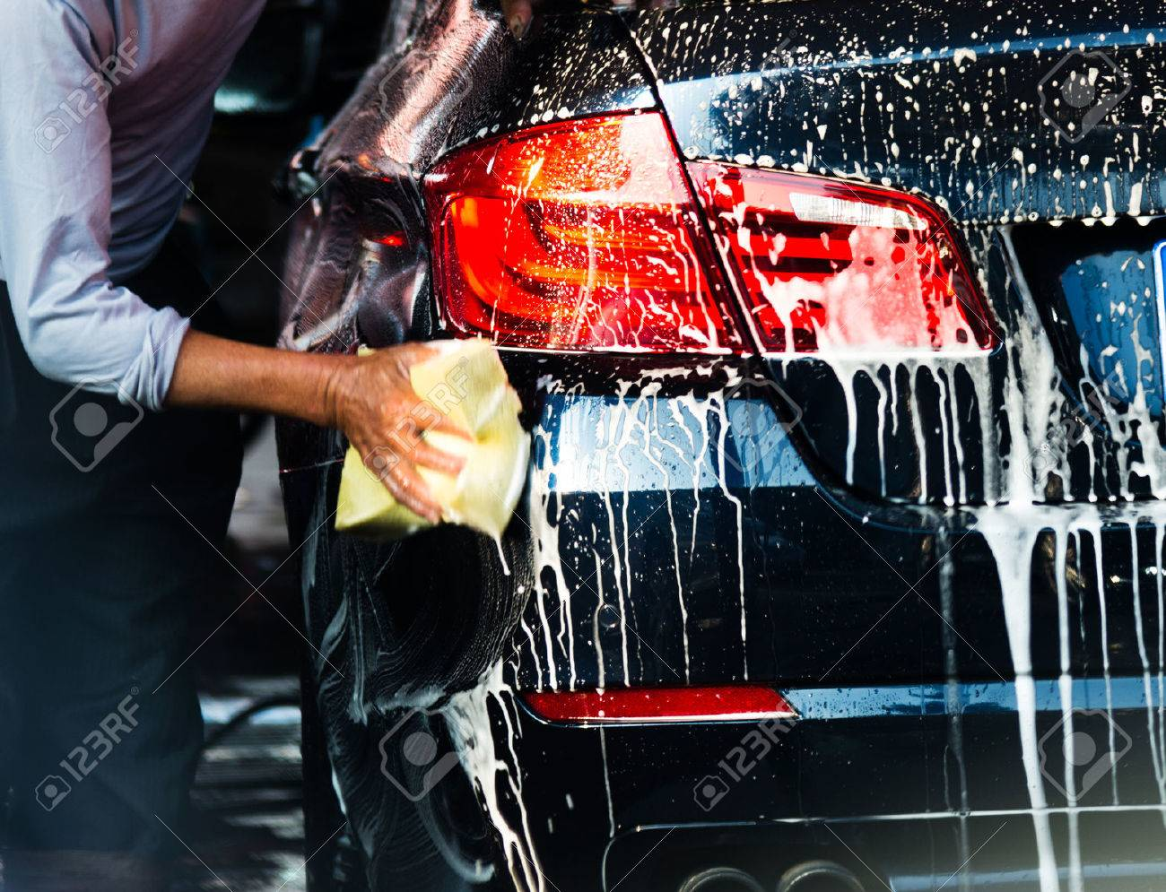 Car wash with flowing water and foam. Stock Photo - 35413998