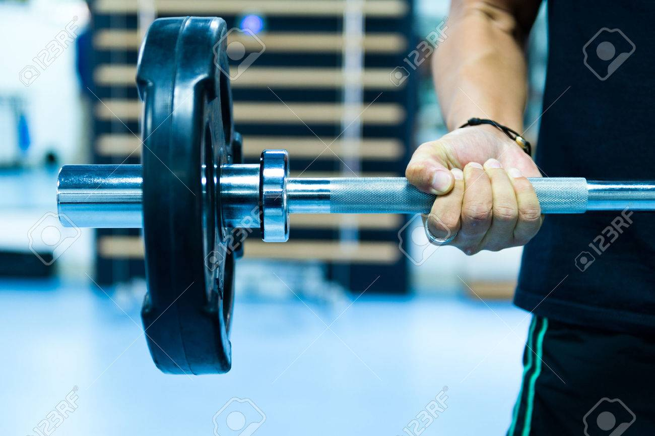 Man with training equipment on sport gym Stock Photo - 35414292