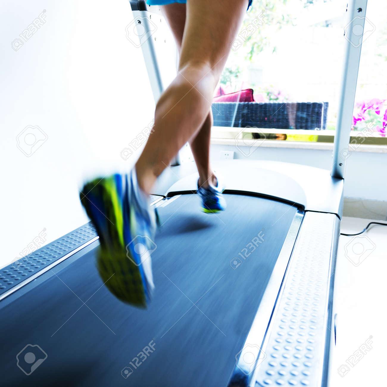 People running on a treadmill Stock Photo - 35414547