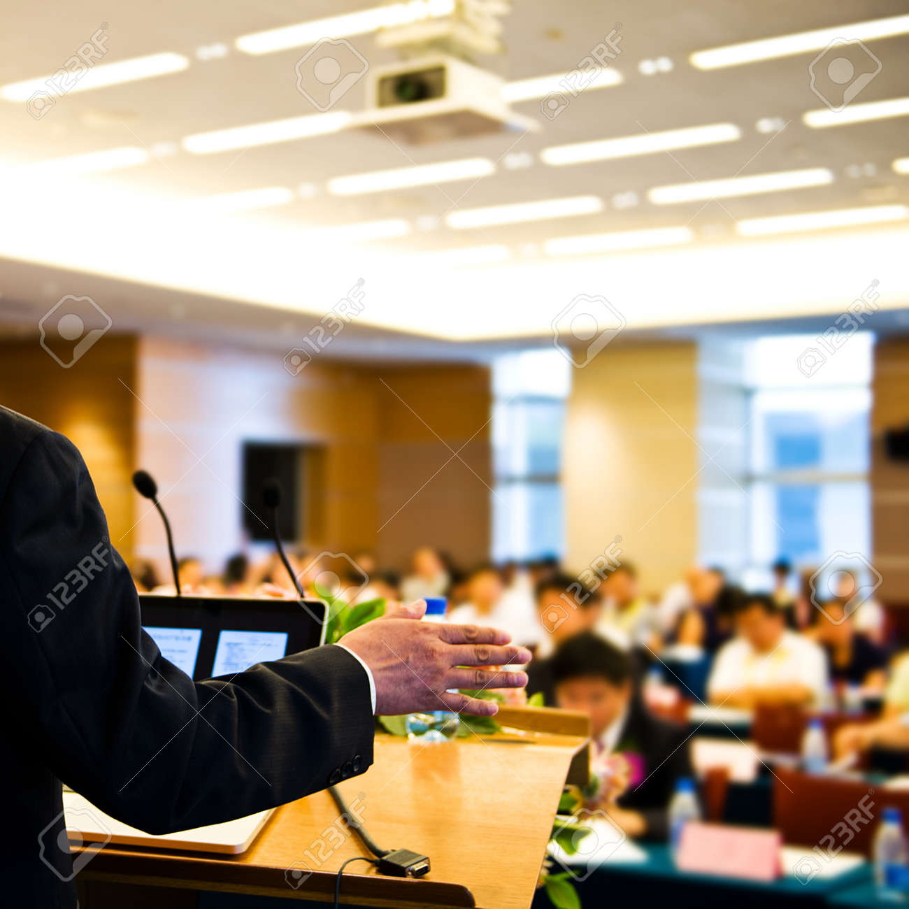 Business man making speech at a conference hall. Stock Photo - 37297008