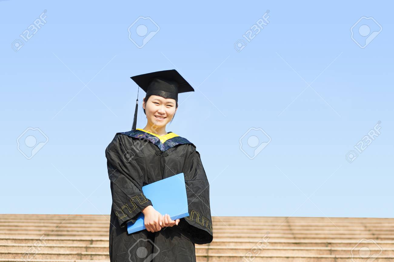 Beautiful Female Graduate Wearing A Graduation Gown Stock Photo ...