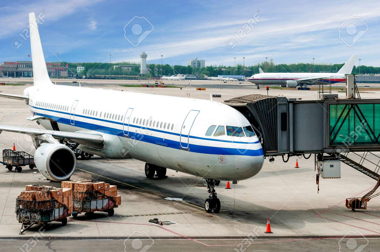 Airplane near the terminal in an airport - 35489833