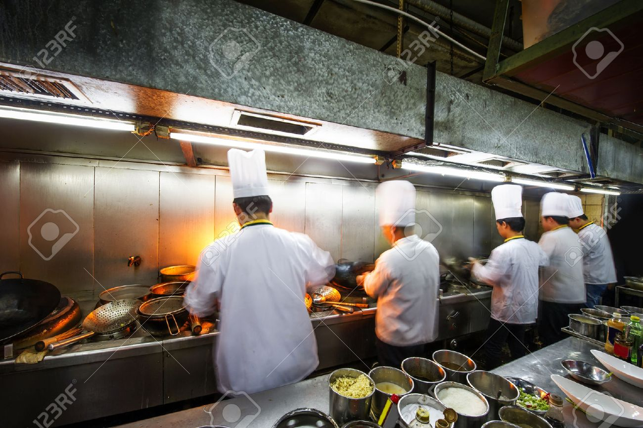 Crowded kitchen, a narrow aisle, working chef. - 35685625