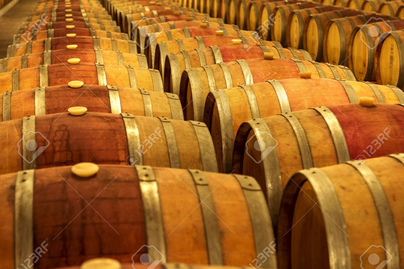 Wine barrels stacked in the cellar of the winery. - 51623864