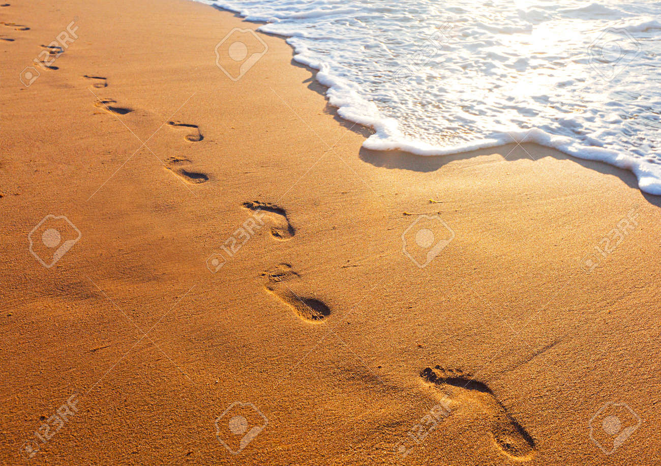beach, wave and footsteps at sunset time - 17248991