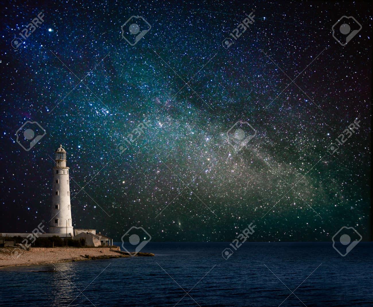lighthouse at night - 20329315