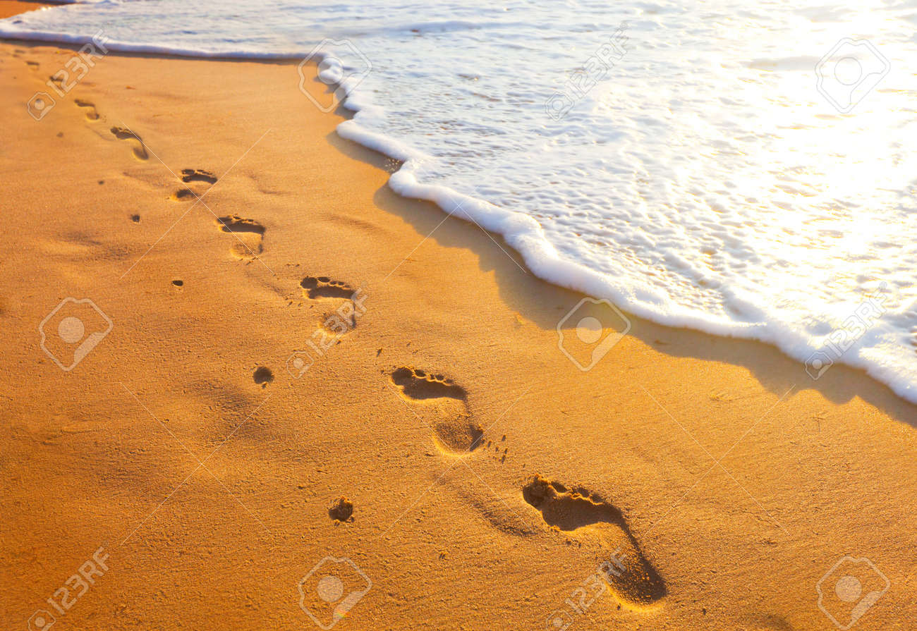 footsteps of one-legged people at sunset time - 23133162