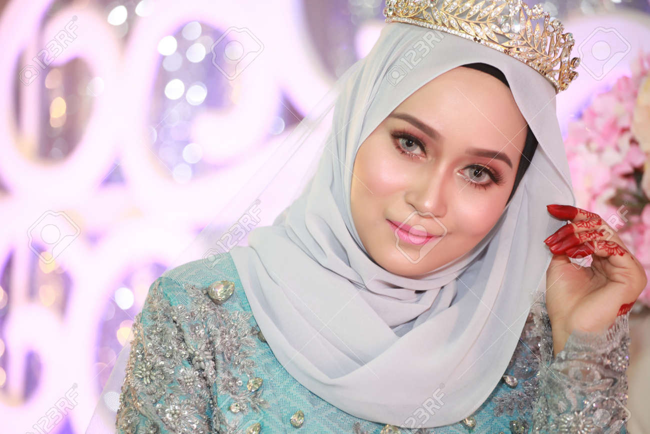 A Beautiful Malay Woman At Wedding Ceremony With Bridal In Malaysia ...