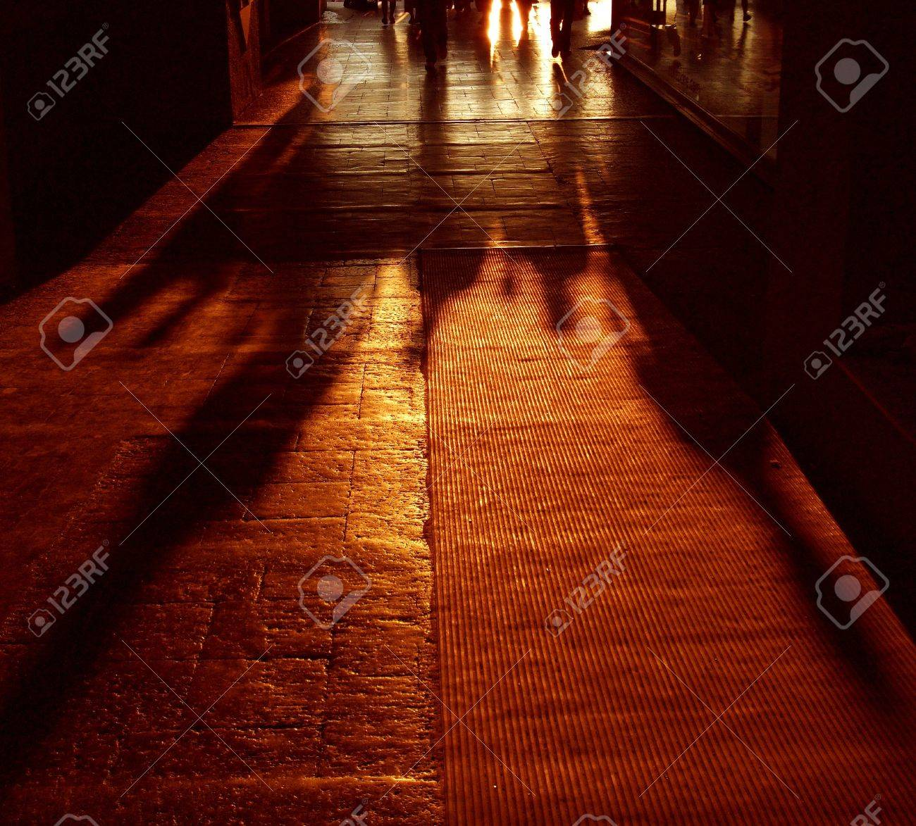 Shadows of Walking People in Sunset Stock Photo - 8621419