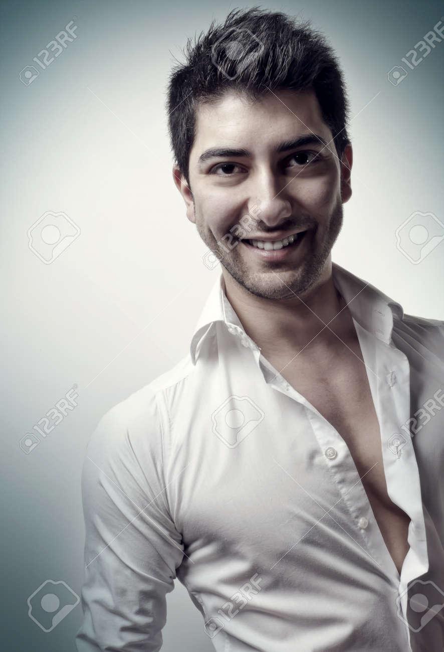 Studio portrait of a smiling, handome man in white shirt Stock Photo - 9079541