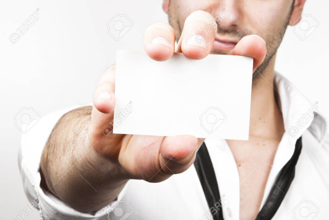 Image of a young and sexy business man showing his businesscard on white Stock Photo - 10100003
