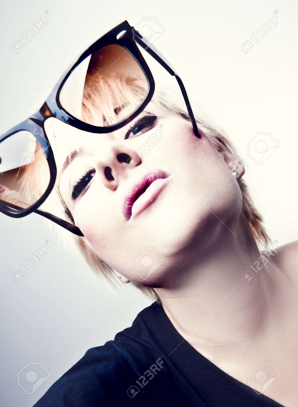 Portrait of a young, blonde girl with short hair and sunglasses Stock Photo - 10162739