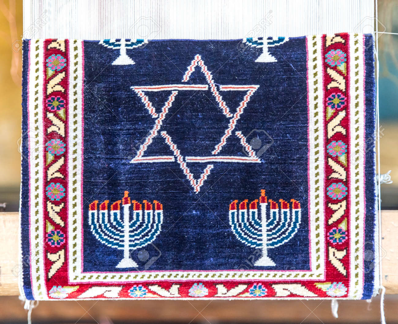 Handcrafted carpet with jewish symbols menorah and magen david handcrafted carpet with jewish symbols menorah and magen david stock photo 73874959 biocorpaavc Image collections