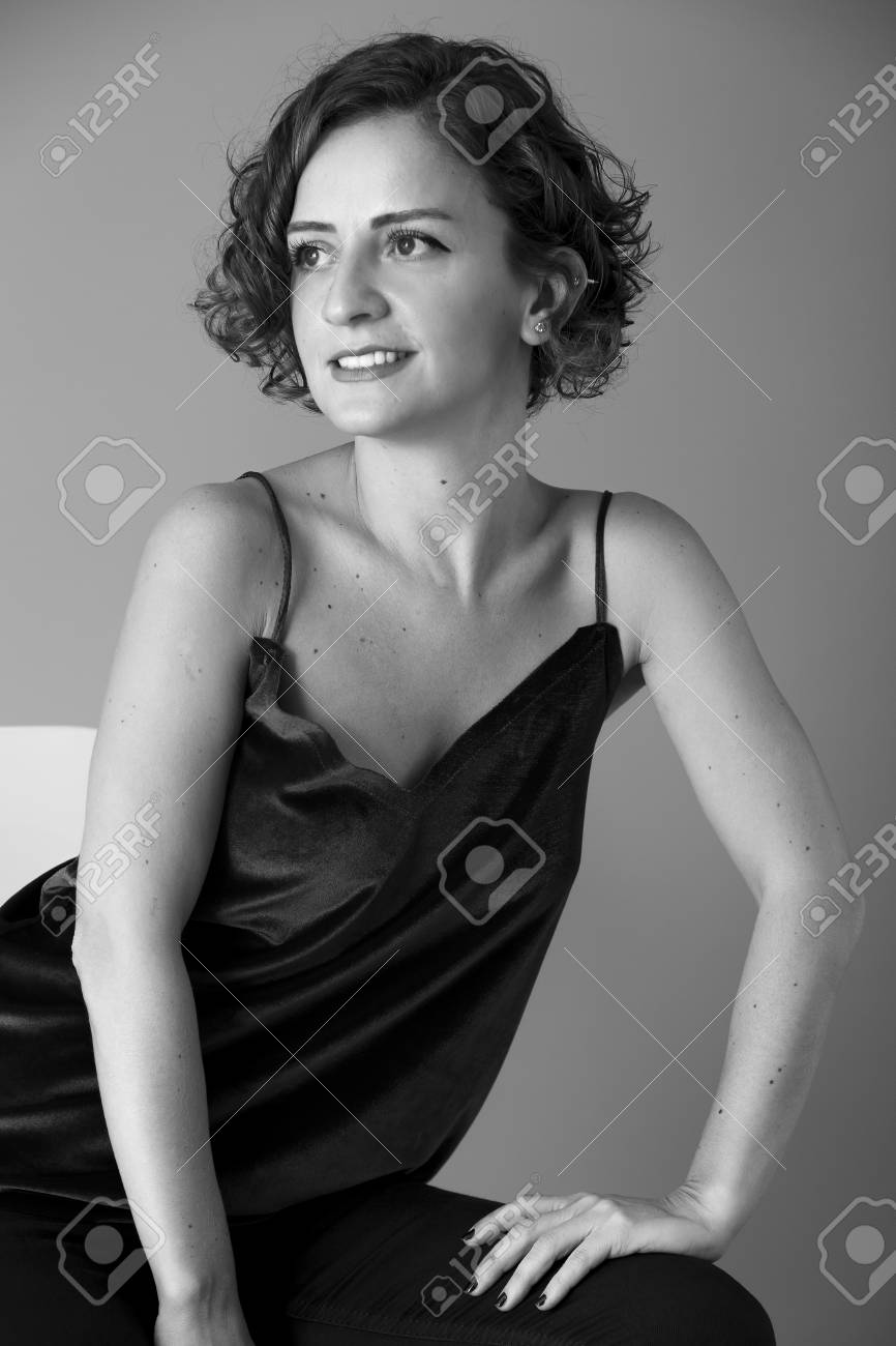 Young Woman With Short Curly Hair Black And White Studio Portrait