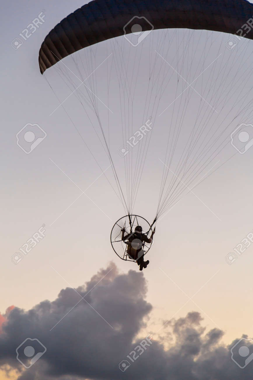 Paramotor, motor-powered paragliding parachute in the sky