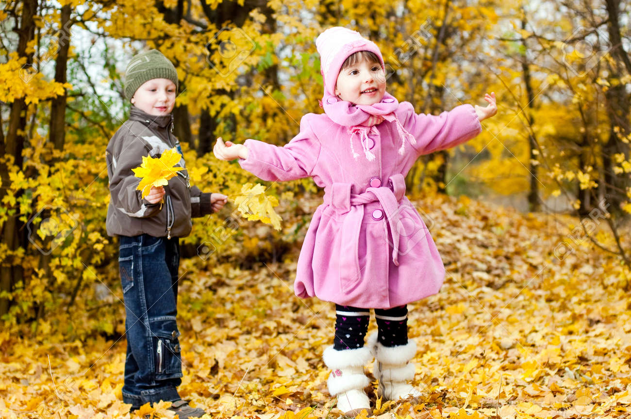 Little boy and girl play in a park in autumn Stock Photo - 13849959