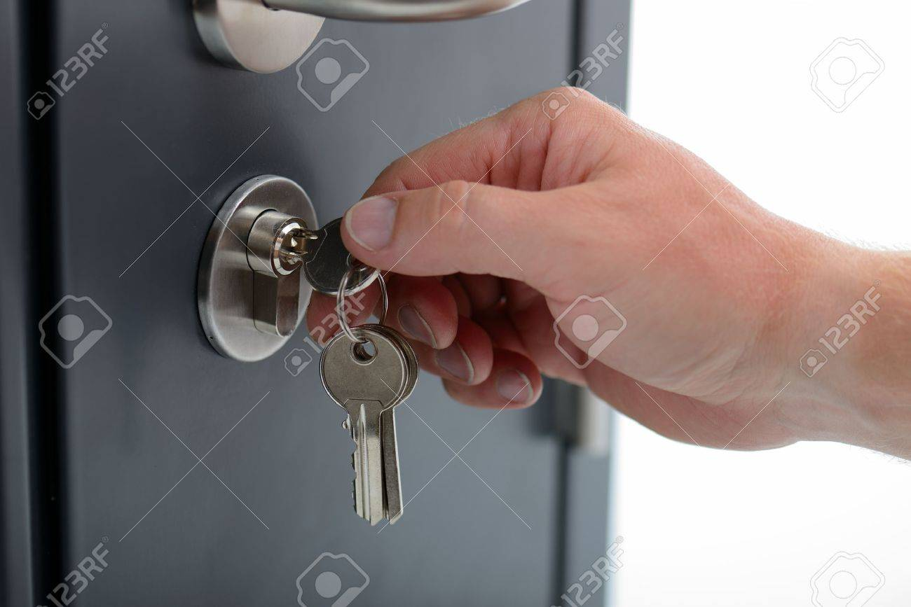 locking or unlocking a security key on a door Stock Photo - 15099101 & Locking Or Unlocking A Security Key On A Door Stock Photo Picture ...