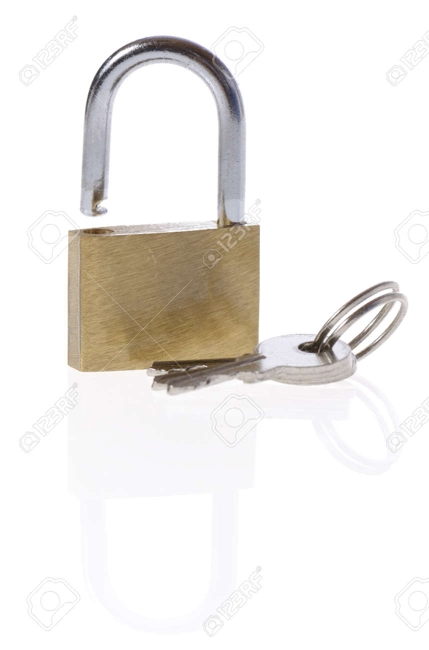 Macro of a locked padlock with the key on it Stock Photo - 16385262