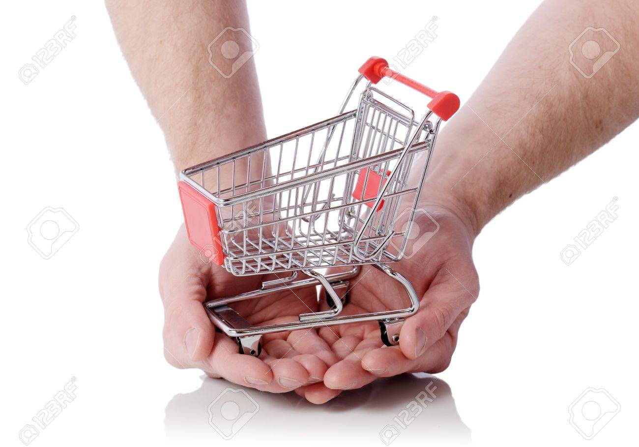 Hand holding shopping cart trolly isolated on white, concept of shopping at your finger tips Stock Photo - 18716724