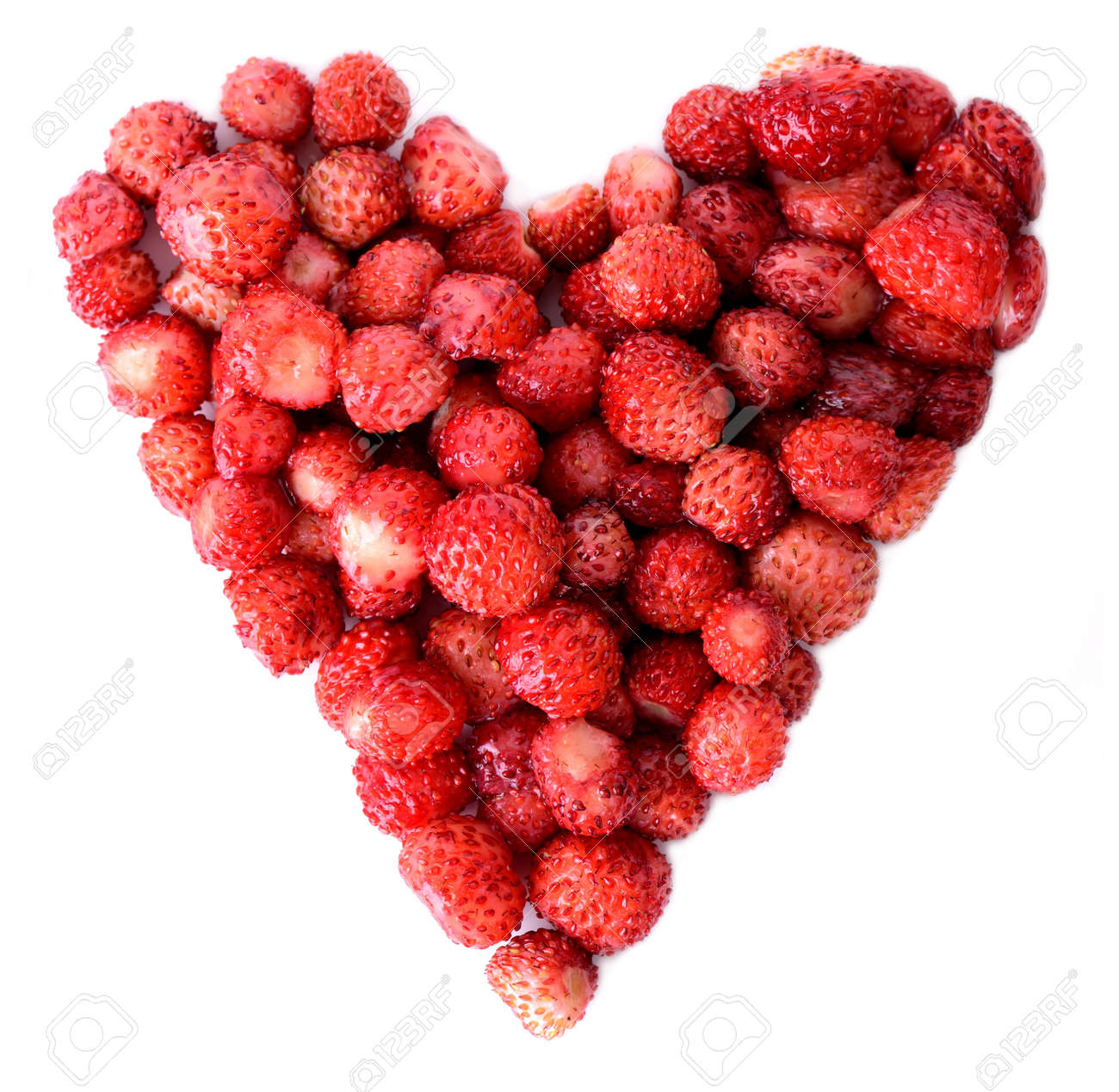 wild strawbeeries in the heap of a heart isolated on white Stock Photo - 21172231