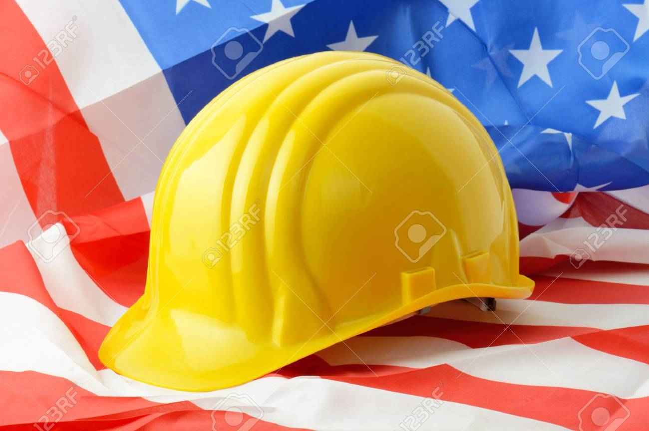Hard hat on a american flag a symbol of construction stock photo hard hat on a american flag a symbol of construction stock photo 27368244 buycottarizona Image collections
