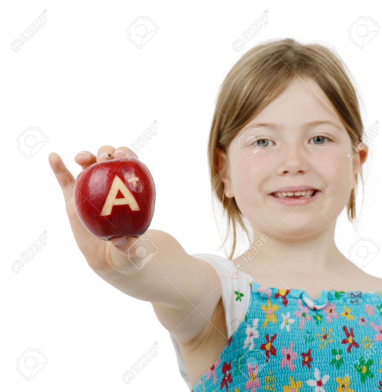 7c72a5dbadb0 School Girl With Top Marks An A Plus Symbol On A Red Apple