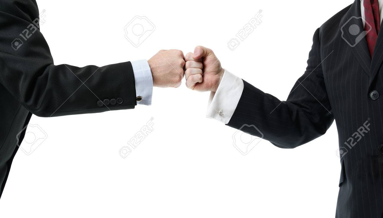 Two businessmen greeting with a fist bump isolated on white stock stock photo two businessmen greeting with a fist bump isolated on white m4hsunfo
