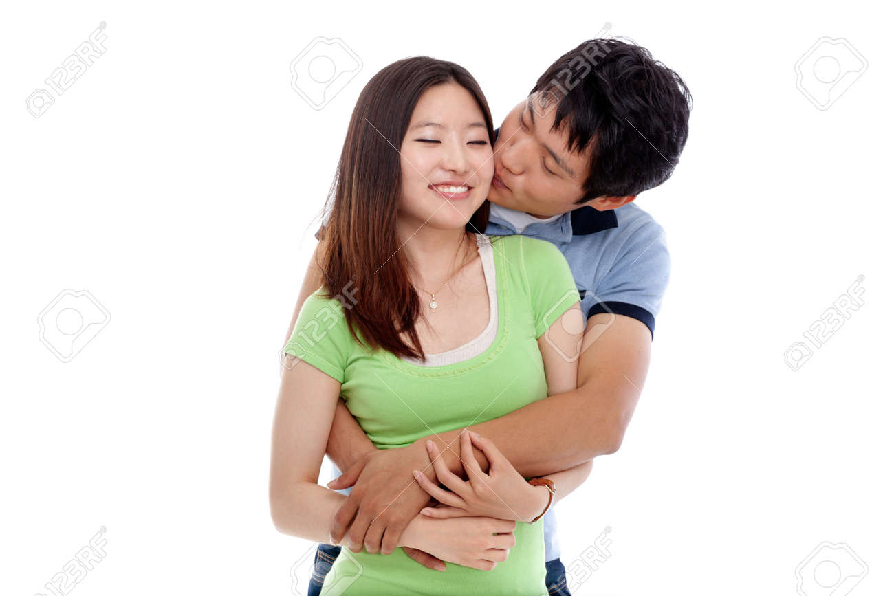 Happy couple hugging and kissing over white background Stock Photo    14022271. Happy Couple Hugging And Kissing Over White Background Stock Photo