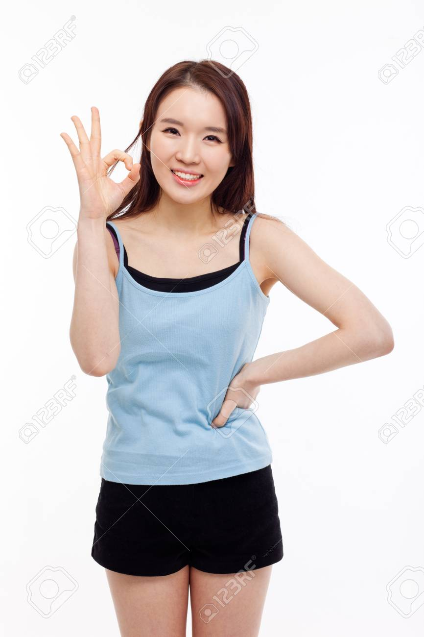 Cute woman with okay hand gesture isolated on white background. Stock Photo - 17446809