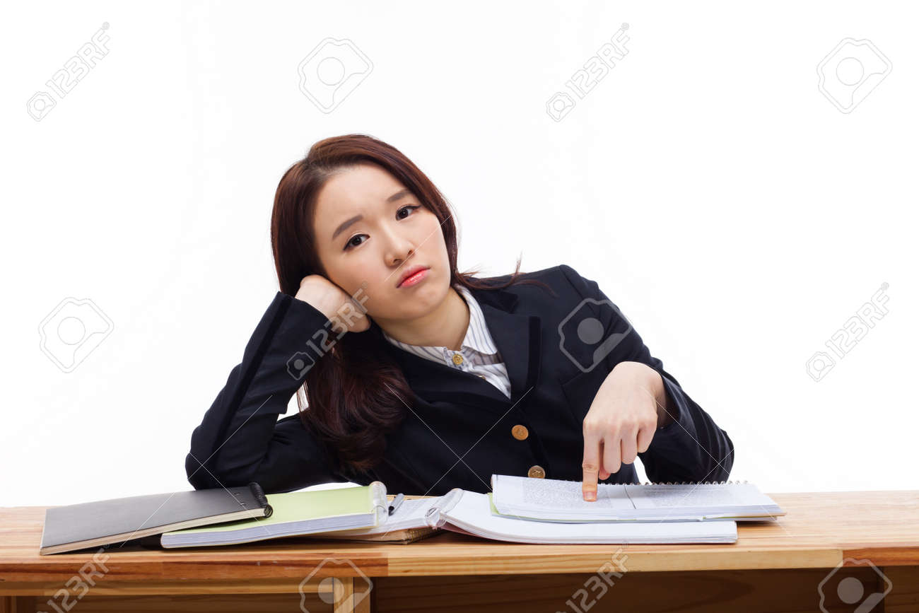 Young Asian student having trouble on the desk isolated on white background. Stock Photo - 17446836