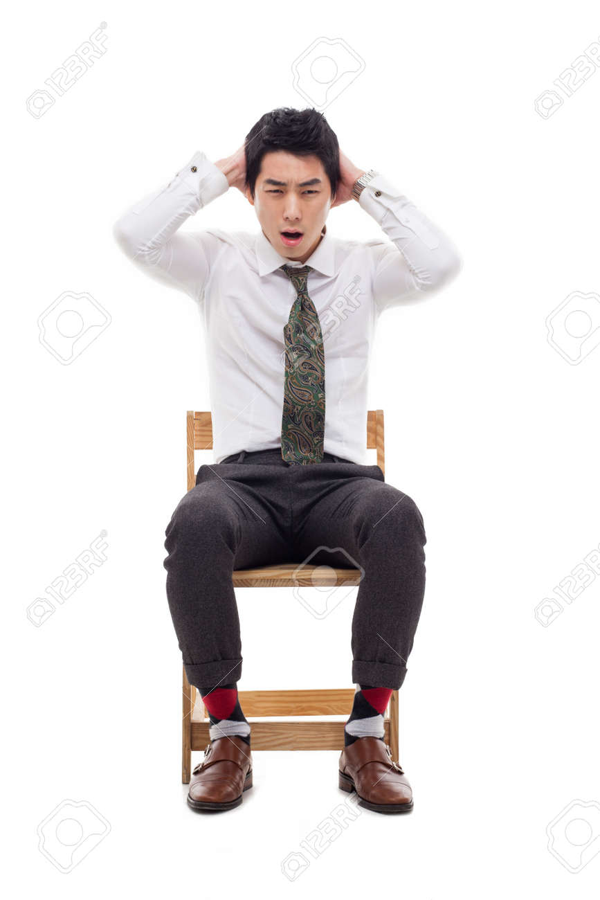 Young Asian man having a stress on isolated on white background. Stock Photo - 17686994